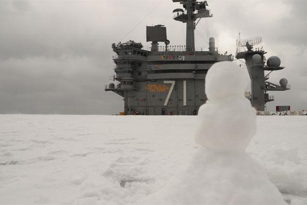 013014-snowman-sits-on-snow